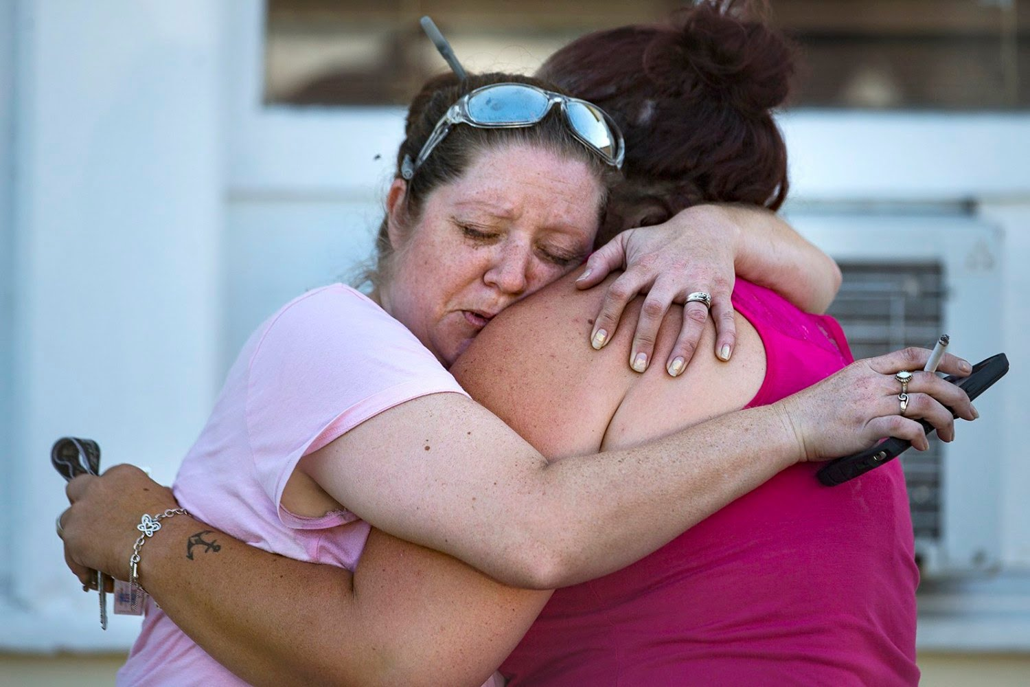 Image: Carrie Matula embraces a woman after a fatal shooting at the First Baptist Church in Sutherland Springs