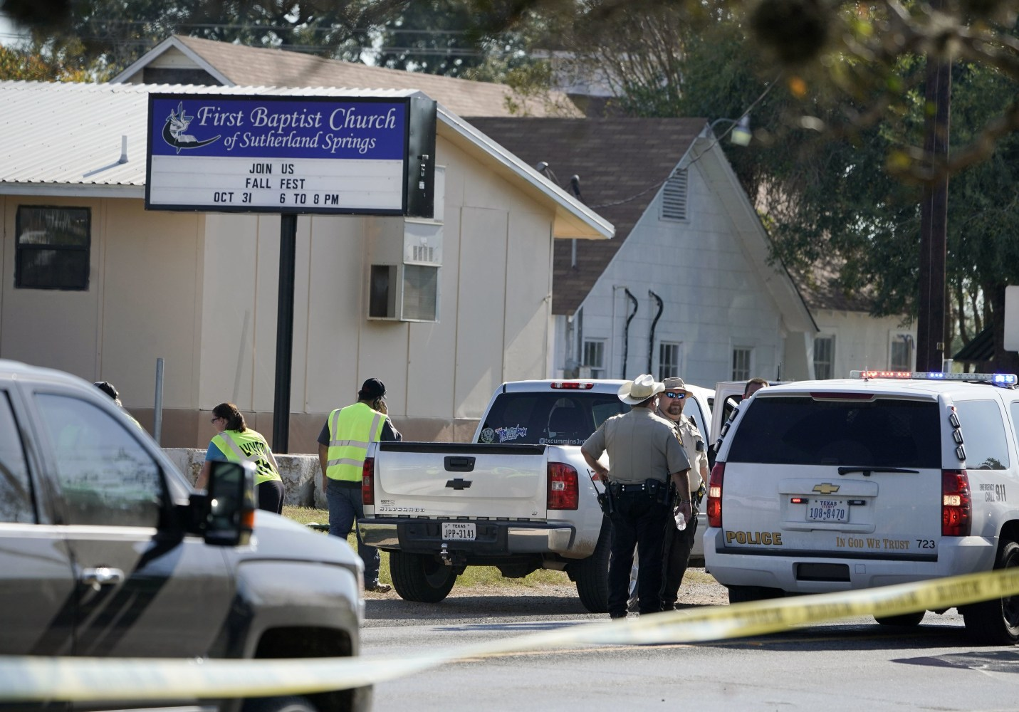 Image: Law enforcement officers gather in front of First Baptist Church of Sutherland Springs after a fatal shooting